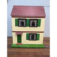 A Triang Toys dolls house with a wooden roof and paper clad walls, with furniture, 42cm h x 33cm w Location: G