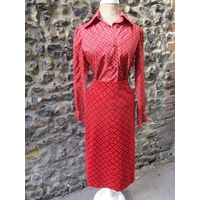 """A 1960's Christian Dior 'Diorling' 2 piece ladies outfit comprising a skirt 24"""" waist x 28"""" long and a blouse 32/34"""" chest, in a red and black geometric design Location: Rail 1"""