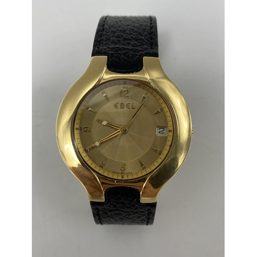 An Ebel Lichine gents automatic 18ct yellow gold wristwatch, the dial having a machine turned centre with date aperture at 3, the case back numbered 8080980 and hallmarked 18k, on a leather strap and original 18ct deployment clasp, with original box and manual, 37mm