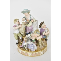 A 19th century Meissen porcelain group 'The Five Shepherds', model number G.13, 18cm high Condition: two fingers on girl with dog are missing, dogs ears restored, boy with lamb has broken item in hand, girl at the back restored at torso, girl in the middle with restored bonnet, chip to underside of base