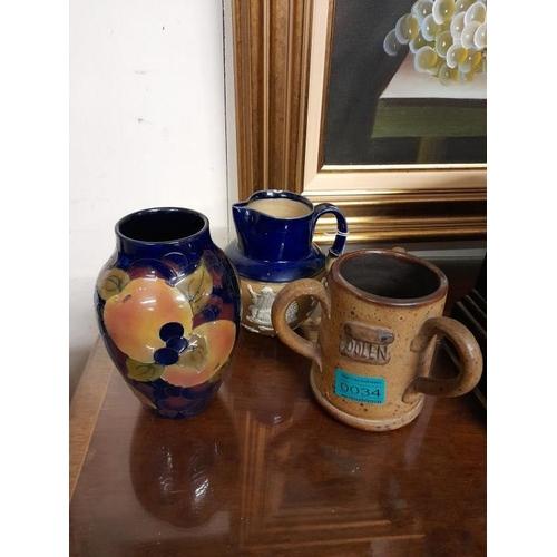 34 - Royal Doulton Pottery Mug (chip), a three handled Cider Mug and an Royal Stanley Vase...