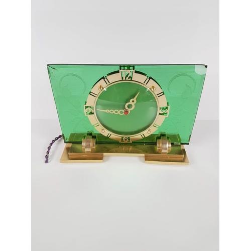 14 - An Art Deco Green Glass & Brass Mantle Clock....