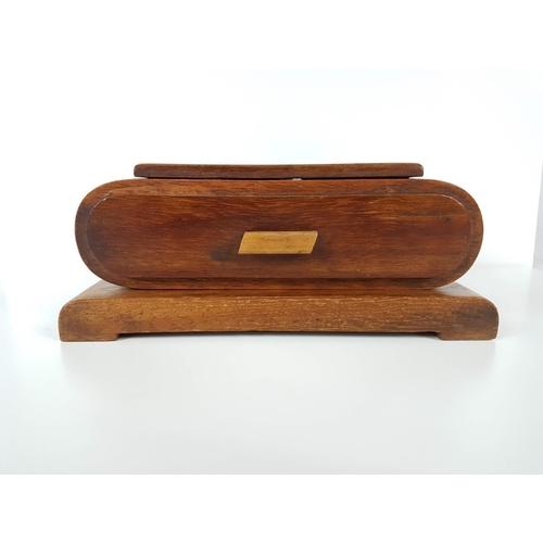 23 - An Art Deco Four Tier Desk Top Cigarette Box....
