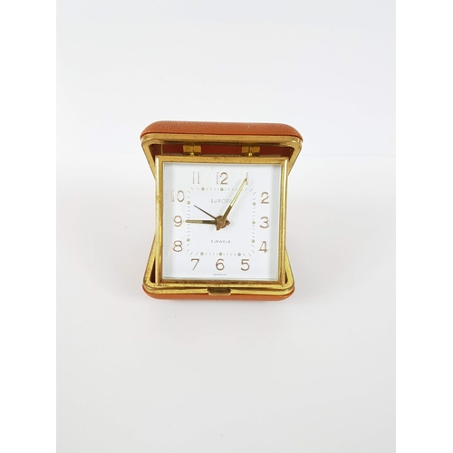 81 - A 1960's Europa Wind Up Travel Clock In Tan Case - In Full Working Order....
