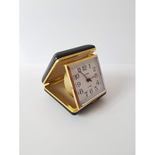 82 - A 1960's Zorba Wind Up Travel Clock In Black Case - In Full Working Order....