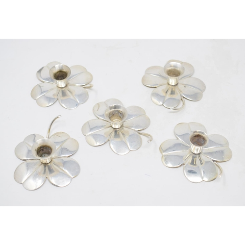 1 - A set of five Swedish silver coloured metal candle holders, in the form of flowerheads, 8 cm wide, o...