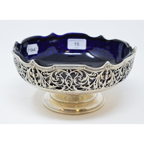 15 - A George V silver pedestal bowl, with pierced foliate decoration and blue glass liner, Barker Brothe...