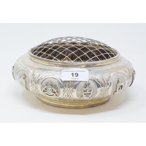 19 - A Malaysian silver coloured metal posy bowl and mesh cover, the sides embossed with the twelve Malay...
