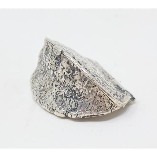 29 - A novelty silver vesta case, in the form of a brazil nut, 5.5 cm wide...