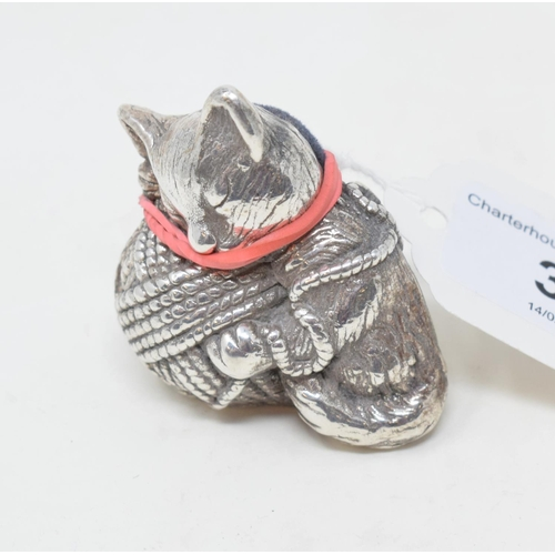 30 - A novelty silver pincushion, in the form of a kitten with a ball of wool, 4.5 cm high...
