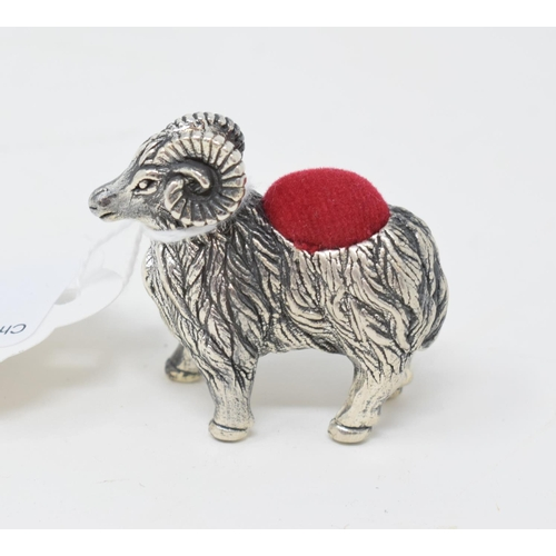 31 - A novelty silver pincushion, in the form of a ram, 3.5 cm high...