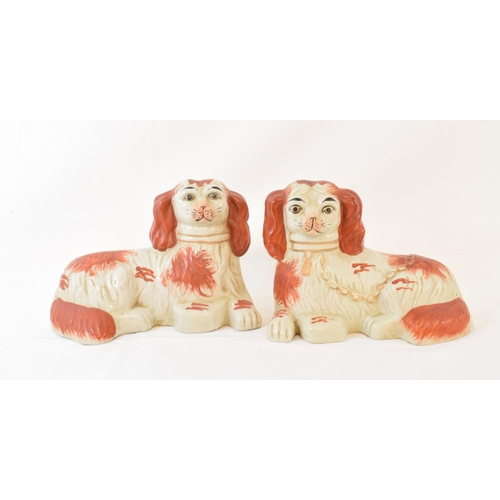 400 - A large Staffordshire pottery spaniel, 37.5 cm high, other Staffordshire and a quantity of majolica ...