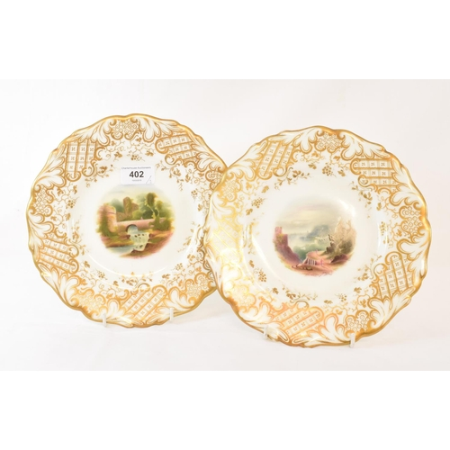 402 - A pair of 19th century porcelain plates, one painted Warwick Castle, the other Oystermouth Swansea B...