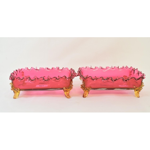 407 - A pair of cranberry glass rectangular dishes, 22 cm wide and four other glass items (6)...