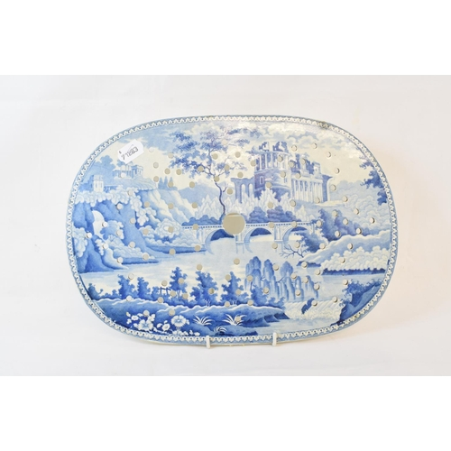 408 - A 19th century blue transfer printed drainer, decorated a castle, 37.5 cm wide, an English blue and ...