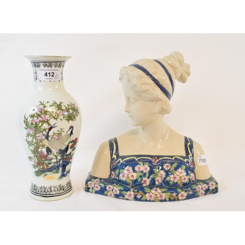 412 - A pottery bust, of a lady, 26 cm high, and a vase (2)...