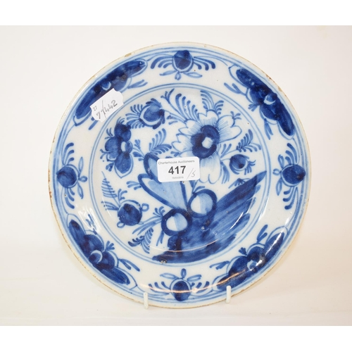 417 - A Delft blue and white pottery plate, decorated flowers, 23 cm diameter, and four others (5)...