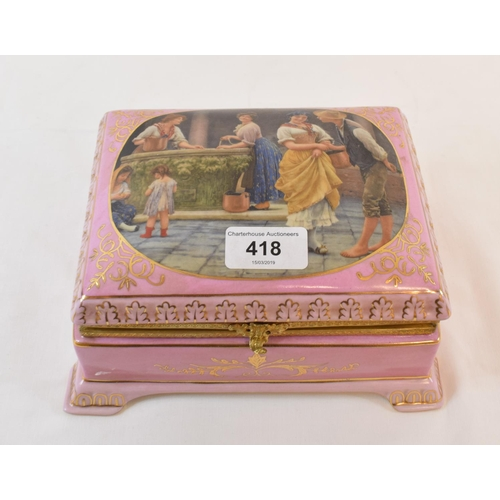 418 - A pink porcelain box and cover, the cover decorated a courting scene, 20 cm wide...