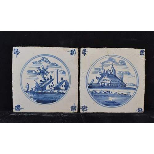 427 - A quantity of Delft tiles, decorated buildings and landscapes (26)...