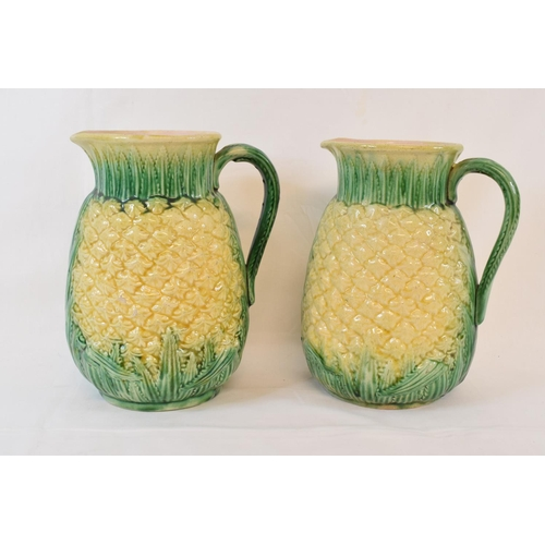 428 - A pair of pottery jugs, in the form of pineapples, 21 cm high, a Meissen part dinner service, the tu...