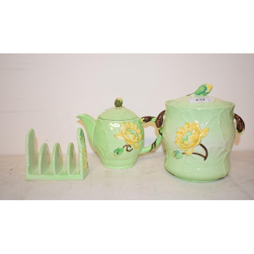 432 - A Carlton Ware Yellow Lily teapot and cover, 1786 (?), 13 cm high, a similar toast rack, a biscuit j...