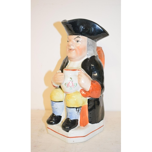 433 - A Staffordshire pottery Toby jug, glue repaired, 23.5 cm high, other ceramics, glass and items (5 bo...