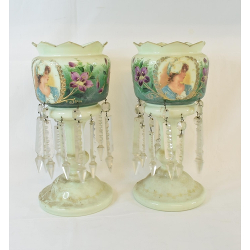 435 - A pair of pink glass lustres, with gilt decoration, 33.5 cm high, another pair with painted decorati...