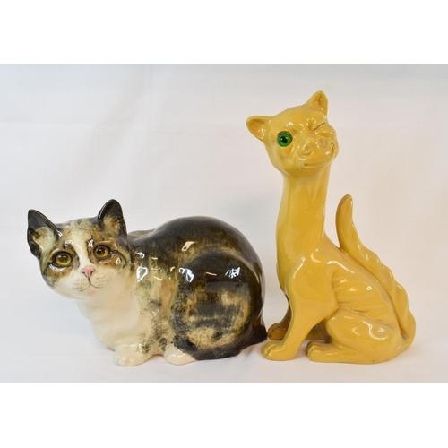 437 - A Winstanley pottery cat, 18.5 cm high, an Aller Vale pottery winking cat, 30.5 cm high and a Falcon...