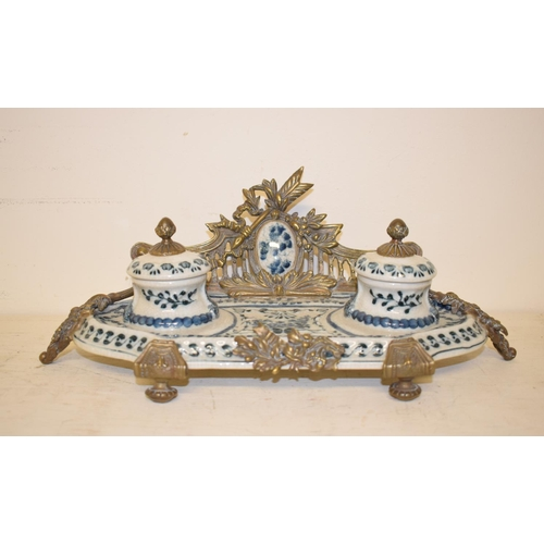 452 - A Continental pottery inkstand, decorated flowers with brass mounts, 32 cm wide, other ceramics and ...