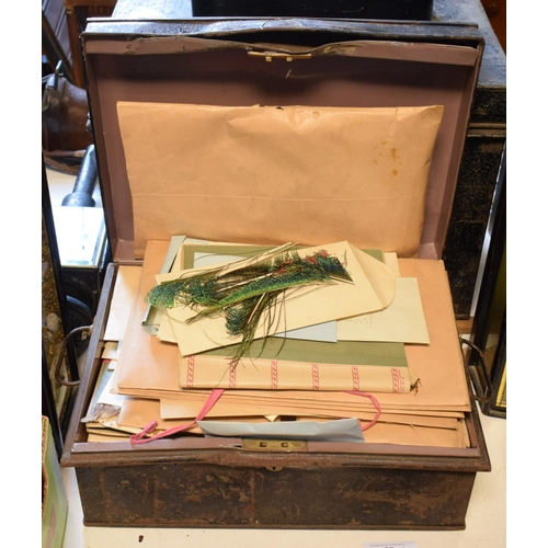 56 - A collection of fishing hackle, early 20th century, organised in envelopes and folders, in a metal d...