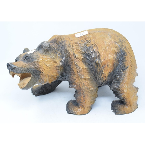 23 - A Black Forest style carved wood grizzly bear, 38 cm wide...