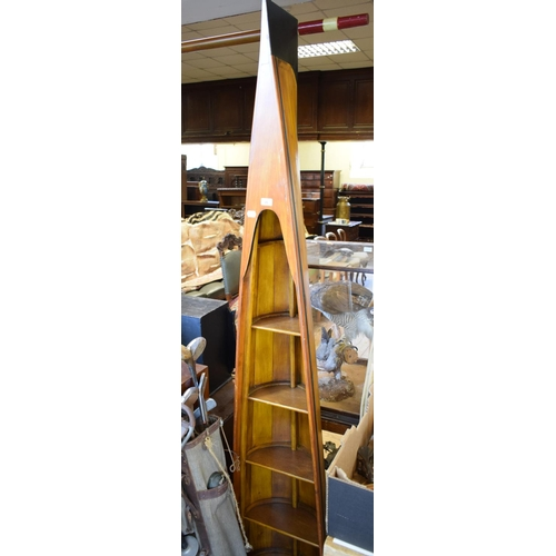 25 - A set of bookshelves, in the form of the stern of a rowing boat, 125 cm high...