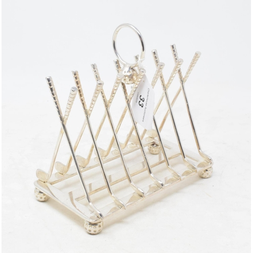 33 - A plated toast rack, in the form of crossed golf clubs, 16 cm high...