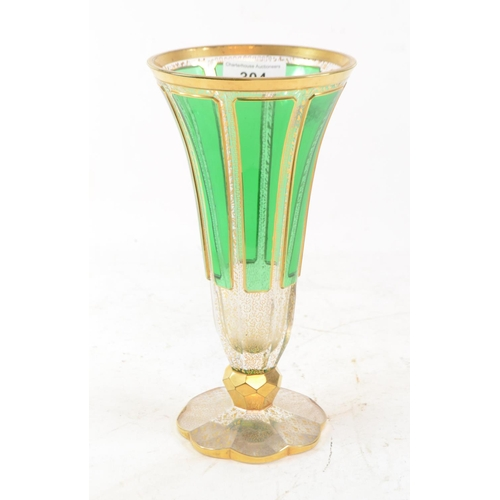 304 - A Bohemian clear and green glass trumpet vase, with gilt decoration, 22.5 cm high...