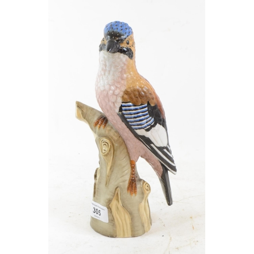 305 - A Continental porcelain figure, of a Jay perched upon a tree stump, 25.5 cm high...