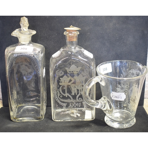 308 - An early 20th century etched glass decanter, 20 cm high, another decanter and stopper and other glas...