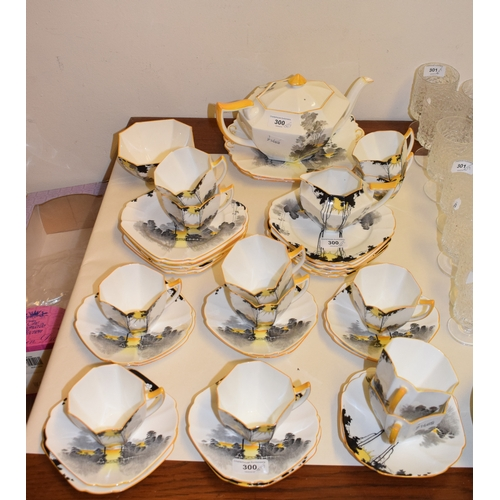 300 - A Shelley Queen Anne Sunrise pattern tea service, for twelve place settings, G11678, some damage See...