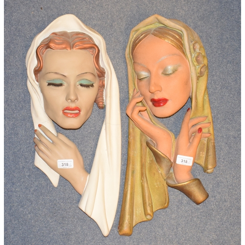 318 - An Art Deco style wall plaque, in the form of a lady wearing a head scarf, 45 cm high, four others, ...