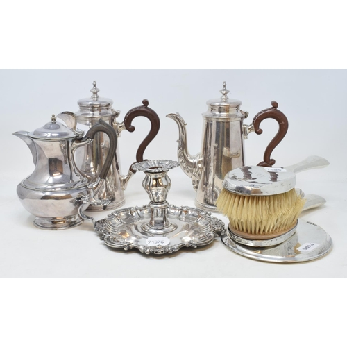 1 - A silver plated two piece café au lait set, a silver plated chamberstick, and other plated items (bo...