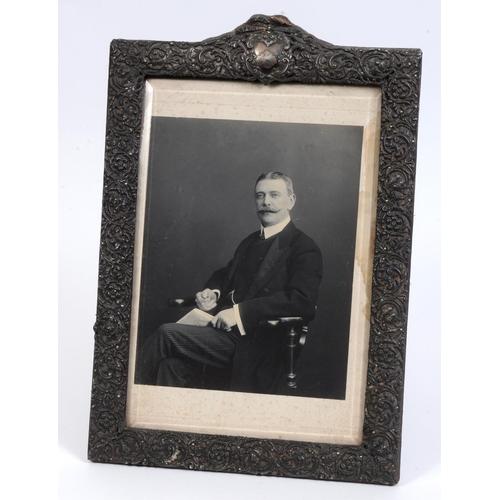 10 - A Victorian silver strut photograph frame, crested, Birmingham 1900, 48.5 cm high See illustration...