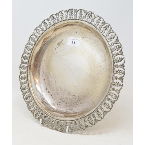 19 - A silver coloured metal dish, the border pierced palmettes, anthemions and acanthus leaves, 29.5 cm ...