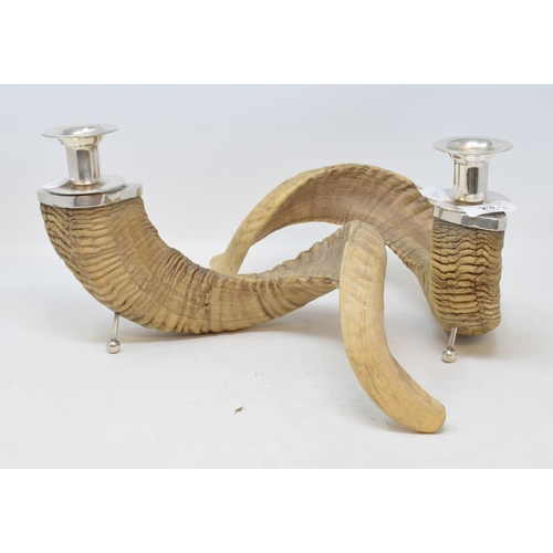 23 - A pair of candlesticks, made from ram's horns, with plated mounts, 16.5 cm high...