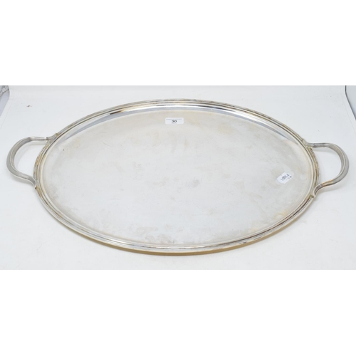 30 - A Christofle silver plated oval tray, with two handles, 63 cm wide...