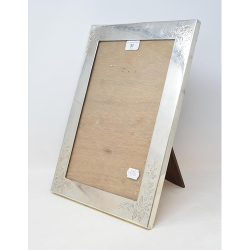 31 - A Japanese silver coloured metal strut photograph frame, with floral decoration, 40.5 cm high...