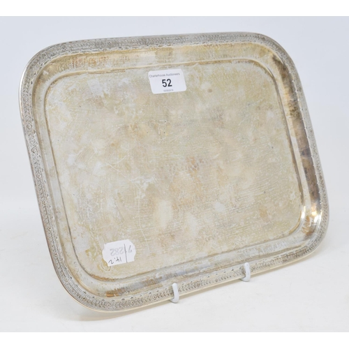 52 - A silver tray, the border decorated flowerheads and leaves, Liberty & Co, Birmingham 1916, approx. 2...
