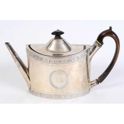 55 - A late 18th century silver teapot, initialled, of navette form, with engraved decoration, London 179...