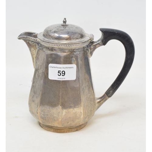 59 - A silver hot water jug, Mappin & Webb, marks rubbed, approx. 12.8 ozt (all in), 15 cm high...