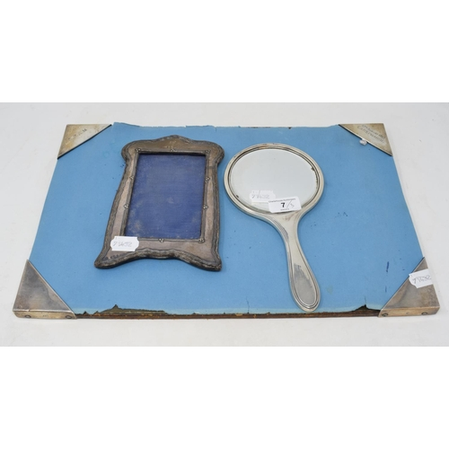7 - A silver mounted desk blotter, initialled, inscribed and dated 1913, London 1913, 44.5 cm wide, a si...