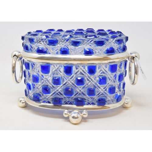 708 - An oval blue and clear glass biscuit box, 16 cm high...