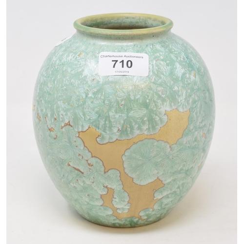 710 - A pottery vase, with a green crystalline glaze, 16 cm high...